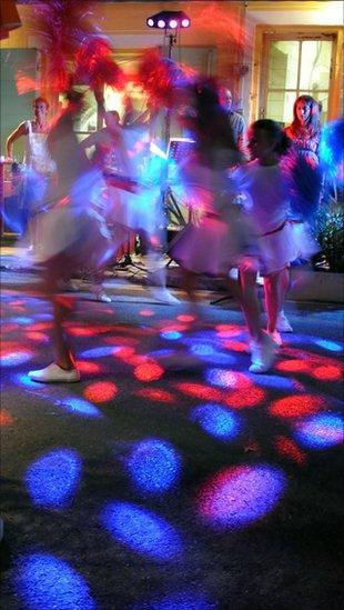 People dance in the street