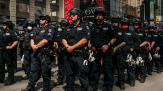 Police in New York City in formation near a protest in Times Square (1 June)