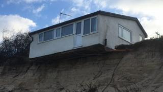 Hemsby house teetering over the sand dune