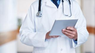 Doctor checking patient records (generic image)