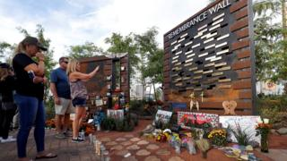 Mourners look at a Remembrance Wall for victims of the Las Vegas shooting, still the deadliest shooting by an individual in US history