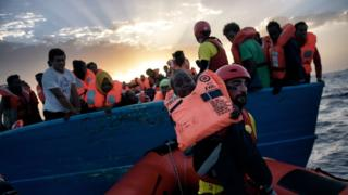 A child from African origin is rescued from a distressed vessel by a member of Proactiva Open Arms NGO in the Mediterranean Sea some 20 nautical miles north of Libya on October 3, 2016.