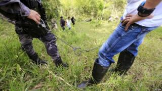 Detained Farc rebel helps locate mass grave near Chaguani, Colombia, July 2015