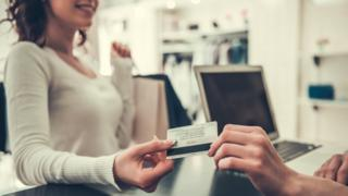 Woman paying with card (generic)