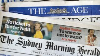 This photo illustration show newspaper front pages of media group Fairfax in Sydney on May 7, 2014.