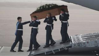 The coffin of Lisa Graham was the first to be carried off the plane at RAF Brize Norton