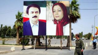 "Maryam Rajavi, (r) the group's leader, is referred to as ""Iran's president in exile"" by followers"