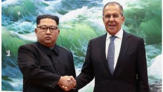 Russian Foreign Minister Sergei Lavrov (R) shakes hands with North Korean leader Kim Jong-un during a meeting in Pyongyang on May 31, 2018
