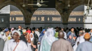 Muslim pilgrims arrive to pray around the Kaaba, Islam's holiest shrine, at the Grand Mosque in Saudi Arabia's holy city of Mecca on August 7, 2019
