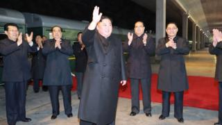 Kim Jong-un boards a private train, ahead of an expected summit with Russian President Vladimir Putin on Thursday