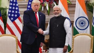 India's Prime Minister Narendra Modi (R) and US President Donald Trump at Hyderabad House in New Delhi on February 25, 2020.