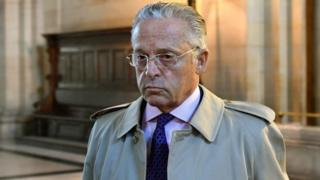 This file photo taken on September 22, 2016 shows French-US art dealer Guy Wildenstein arriving for his trial over tax fraud at the courthouse in Paris