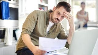 Young family struggles with debt