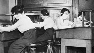 Clerks wearing face masks at work during the Spanish flu pandemic in 1918