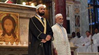 Imam Sami Salem (L) and Imam Mohammed ben Mohammed (R) stand during a mass in Santa Maria church in Rome