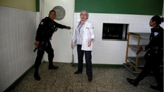 Police officers inside the Roosevelt Hospital in Guatemala City, Guatemala August 16, 2017.