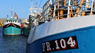 A close up of one of the colourful fishing boats in the port of Macduff.