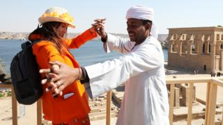 Spanish actress Victoria Abril dancing with a man at the Temple of Philae in Aswan, Egypt - Tuesday 11 February 2020