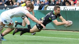 Ospreys wing Tom Habberfield dives over for the opening try