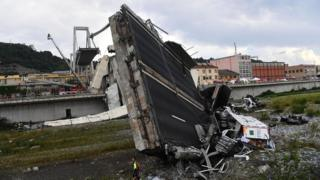 Rescuers at work at the site of the motorway bridge collapse in Genoa, Italy, on 14 August 2018