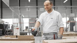 Audi worker scanning boxes