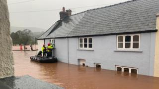 A family on holiday were rescued from a cottage at Usk on the Wye