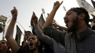 Supporters and members of hard-line Islamist group of Ansar al-Sharia shout slogans during a demonstration against a film mocking Islam in Benghazi (24 September 2012)