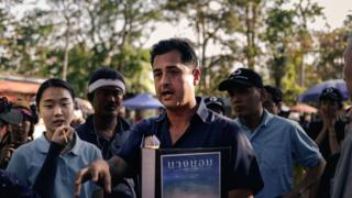 Writer/Director Tom Waller briefing actors on the set of The Cave shooting on location in Thailand.