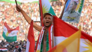 A man show his support for the Kurdish independence referendum in Zakho, Iraq (14 September 2017)