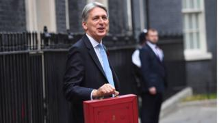Philip Hammond, the chancellor, holds his red box