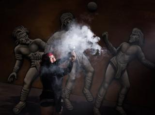 "Mexican Beatriz Campos, player of a pre-Columbian ballgame called ""Ulama"" -in Nahuatl indigenous language- performs the ""Copal"" ceremony ahead of a match at the FARO Poniente cultural centre in Mexico City on August 21, 2019."