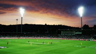 Sunset over cricket ground