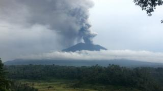 Smoke and ash rise from Mount Agung