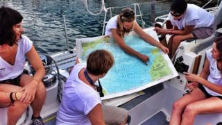 Environmental-campaigner-Emily-Penn-briefing-the-crew.