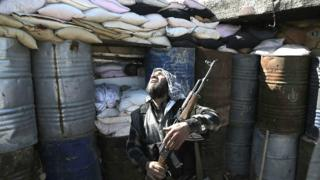 Syrian rebel fighter in the town of Arbin in the eastern Ghouta region on the outskirts of capital Damascus, 26 February 2016