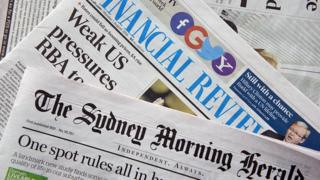 A spread of The Australian Financial Review and The Sydney Morning Herald