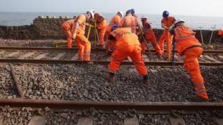 Workers repairing a rail line