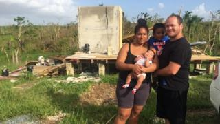 Jose Nieves and family at their wrecked home
