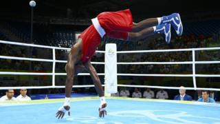 Cameroon's Wilfred Seyi Ntsengue celebrates after winning his bout on Tuesday at the men's middleweight (75kg) fight at the Rio Olympics.
