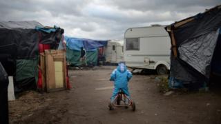 A child in a Calais refugee camp