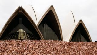 Naked people photographed by Spencer Tunick in front of the Sydney Opera House, 1 March 2010
