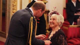 Myrtle Simpson receives the Polar Medal from Prince William