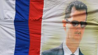 Russian flag with portrait of Bashar al-Assad (file photo)