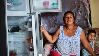 Liliana Rojas shows her empty refrigerator at her home in the poor neighbourhood of Catia, Caracas, June 2, 2016.