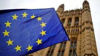 A European Union flag flies outside the Houses of Parliament in London, 23 October 2019