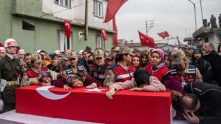 Image shows mourners of a killed Turkish solider