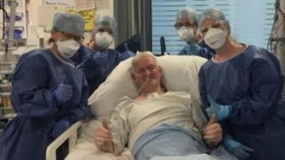 Brian Harvey with the medics who treated him during nine weeks in hospital