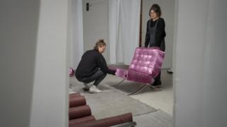 Madeleine Pledge, 25, and Eva Gold, 24, prepare an exhibition at SET