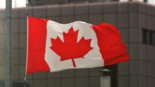 The Canadian flag flies at half mast at Halifax International Airport, Canada