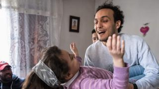 Egyptian photojournalist Mahmoud Abou Zeid, widely known as Shawkan, plays with his niece at his home in Cairo on 4 March 2019